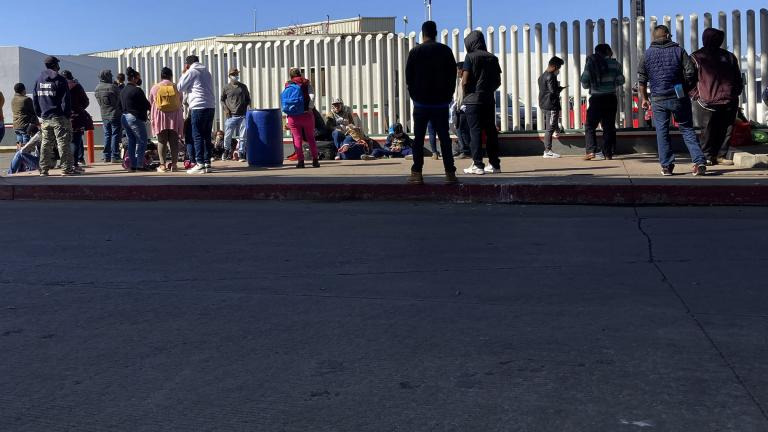 Migrants waiting to cross into the United States wait for news at the border crossing Wednesday, Feb. 17, 2021, in Tijuana, Mexico. (AP Photo / Elliot Spagat)