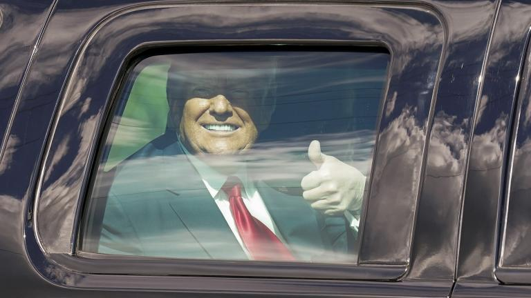 President Donald Trump gestures to supporters en route to his Mar-a-Lago Florida Resort on Wednesday, Jan. 20, 2021, in West Palm Beach, Fla. (AP Photo / Lynne Sladky)
