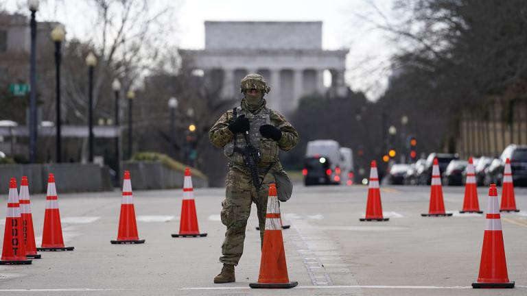 A National Guard stands at a road block near the Supreme Court ahead of President-elect Joe Biden's inauguration ceremony, Wednesday, Jan. 20, 2021, in Washington. (AP Photo / Gerald Herbert)