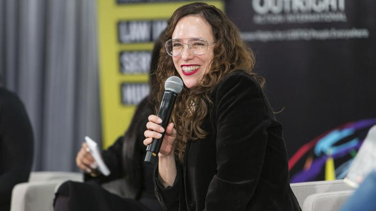 In this Dec. 7, 2019 photo provided by Brad Hamilton, Jessica Stern, head of Outright International, speaks during the OutSummit in New York. (Brad Hamilton / OutRight Action International via AP)
