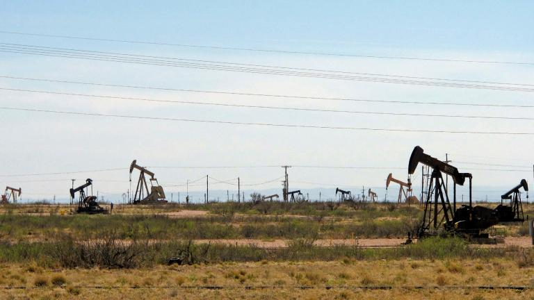 In this April 9, 2014, file photo, oil rigs stand in the Loco Hills field on U.S. Highway 82 in Eddy County near Artesia, N.M., one of the most active regions of the Permian Basin. (AP Photo / Jeri Clausing, File)
