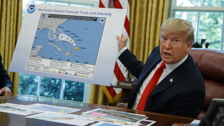 In this Wednesday, Sept. 4, 2019, file photo, President Donald Trump talks with reporters after receiving a briefing on Hurricane Dorian in the Oval Office of the White House, in Washington. (AP Photo/Evan Vucci, File)