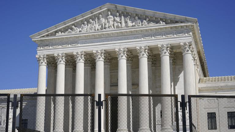 In this March 21, 2021, file photo security fencing surrounds the Supreme Court building on Capitol Hill in Washington. (AP Photo / Patrick Semansky, File)