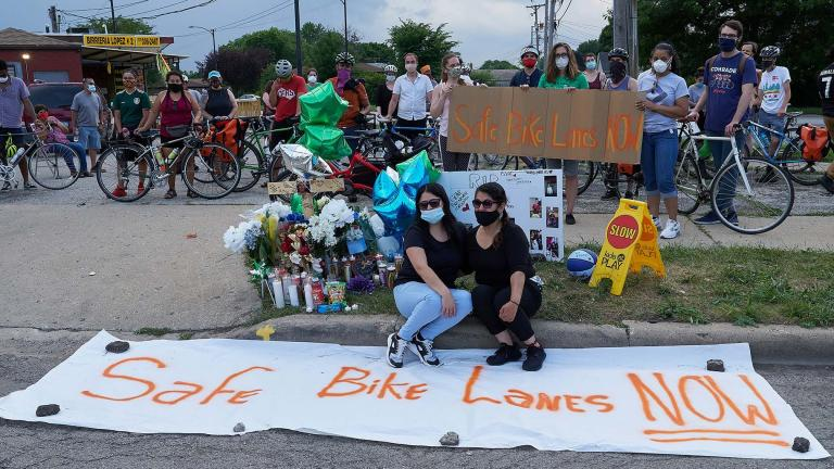 Demonstrators call for bike lanes following the death of Issac Martinez, who was cycling along Lawndale Avenue in June when he was fatally struck by a driver. (@bikelaneuprise / Twitter)