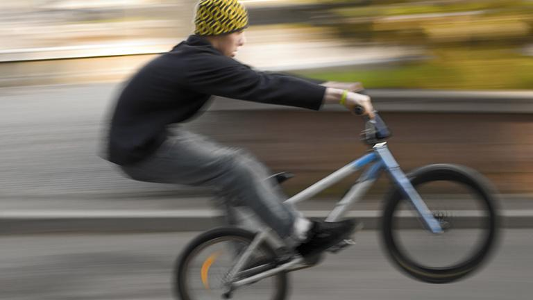 A BMX biker performing a wheelie. (Andrey Marshak / Wikimedia Commons)