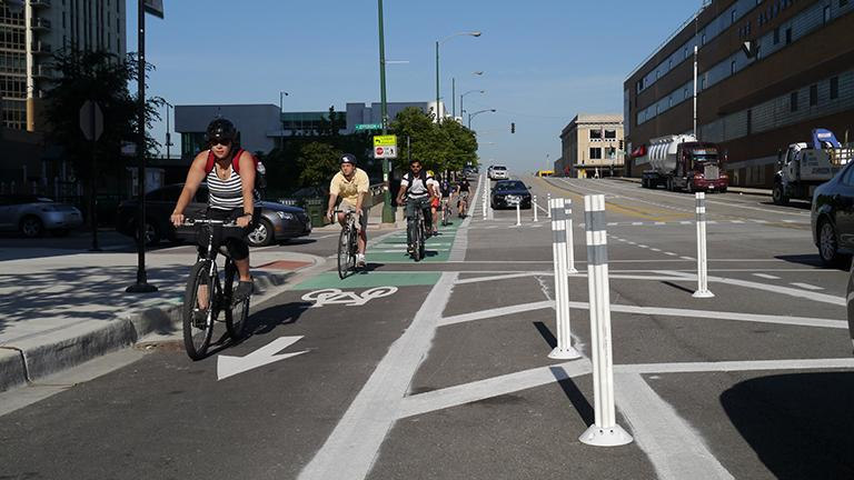 Chicago's first protected bike lane was installed on Kinzie Street in June 2011. On Monday, the city announced plans to design new bike lanes and improve existing ones. (Chicago Bicycle Program / Flickr)