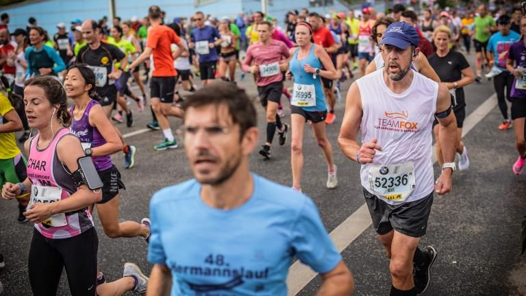 Wilmette resident Bill Bucklew, right, ran in the Berlin marathon on Sept. 29. Bucklew, who was diagnosed with Parkinson's disease at 43, will run in the Chicago marathon on Sunday, Oct. 13. (Courtesy of Bill Bucklew)