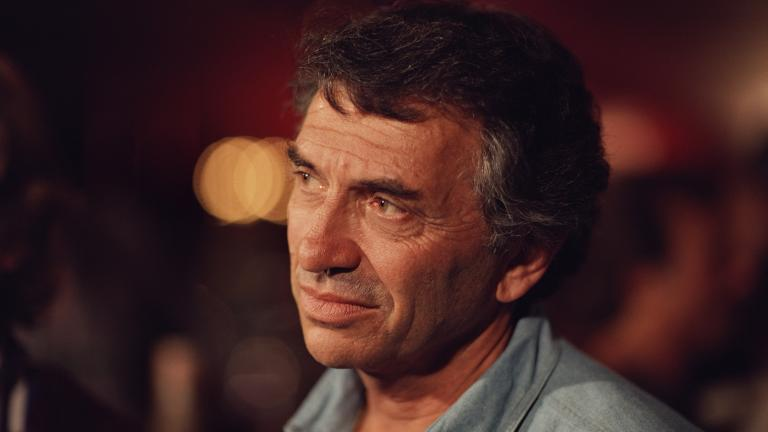 "Bill Graham between takes during the filming of ""A '60s Reunion with Bill Graham: A Night at the Fillmore,"" 1986. (Courtesy of Ken Friedman)"