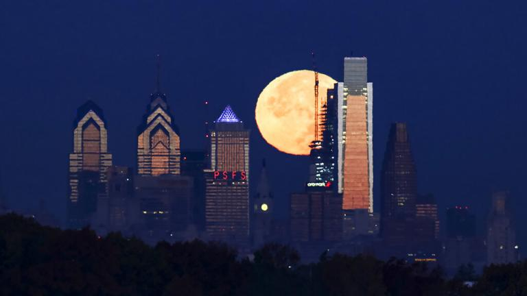 A supermoon sets behind the Philadelphia skyline. Bird Safe Philly announced on Thursday, March 11, 2021, that Philadelphia is joining the national Lights Out initiative, a voluntary program in which as many external and internal lights in buildings are turned off or dimmed at night during the spring and fall bird migration seasons. (AP Photo / Joseph Kaczmarek)