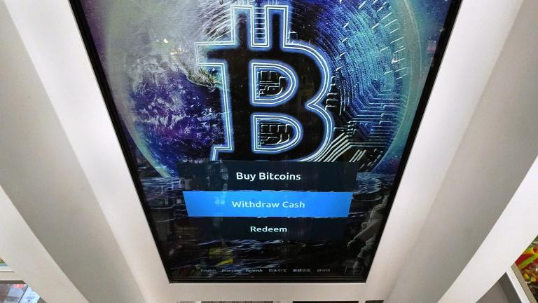 In this Feb. 9, 2021 file photo, the Bitcoin logo appears on the display screen of a crypto currency ATM at the Smoker's Choice store in Salem, N.H. (AP Photo / Charles Krupa, File)