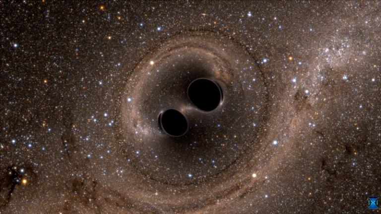 The collision of two black holes—an event detected for the first time ever by the Laser Interferometer Gravitational-Wave Observatory, or LIGO—is seen in this still from a computer simulation. (Credit: SXS)