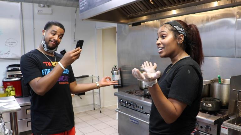 percent loss in revenue during the pandemic. Food blogger Jeremy Joyce films Krissy Harper, owner of Cleo's Southern Cuisine, for his social media account Black People Eats on June 27, 2020. (Evan Garcia / WTTW News)
