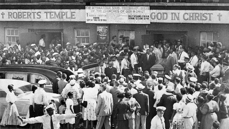 FILE - A large crowd gathers outside the Roberts Temple Church of God In Christ in Chicago, Sept. 6, 1955, as pallbearers carry the casket of Emmett Till, a 14-year-old African-American boy who was slain while on a visit to Mississippi. The African American Cultural Heritage Action Fund is awarding $3 million in grants to help preserve the site and dozens more across the nation. (Chicago Sun-Times via AP)