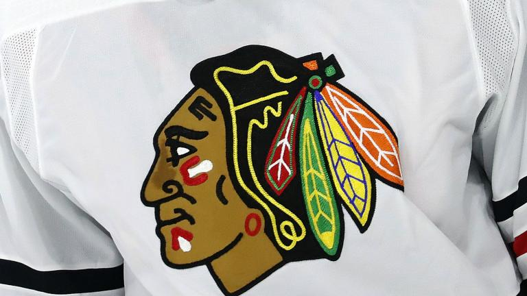 The Chicago Blackhawks logo is shown on a jersey in Raleigh, N.C., in this May 3, 2021, file photo. (AP Photo / Karl B DeBlaker, File)