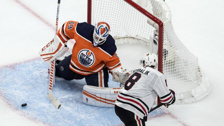 Edmonton Oilers goalie Mikko Koskinen (19) makes a save against Chicago Blackhawks' Dominik Kubalik (8) during third-period NHL hockey Stanley Cup playoff game action in Edmonton, Alberta, Saturday, Aug. 1, 2020. (Jason Franson / The Canadian Press via AP)