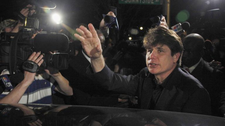 In this March 15, 2012 file photo, former Democratic Illinois Gov. Rod Blagojevich departs his Chicago home for Littleton, Colorado, to begin his 14-year prison sentence on corruption charges. (AP Photo / Charles Rex Arbogast, File)