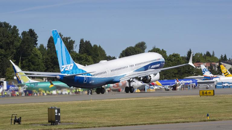 The final version of the 737 MAX, the MAX 10, passes other 737 MAX planes as it takes off from Renton Airport in Renton, Wash., on its first flight Friday, June 18, 2021. The plane will fly over Eastern Washington and then land at Boeing Field. (Ellen M. Banner / The Seattle Times via AP, Pool)