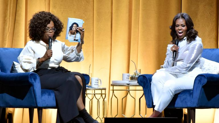 "Michelle Obama, right, appears with Oprah Winfrey to discusses her book ""Becoming"" during her book tour in Chicago on Nov. 14, 2018. (Photo by Rob Grabowski / Invision / AP, File)"