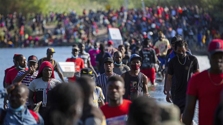 Haiti migrants waiting in Del Rio and Ciudad Acuña to get access to the United States, cross the Rio Grande toward Ciudad Acuña to get supplies, Friday, Sept. 17, 2021, in Ciudad Acuña, Mexico. (Marie D. De Jesús / Houston Chronicle via AP)