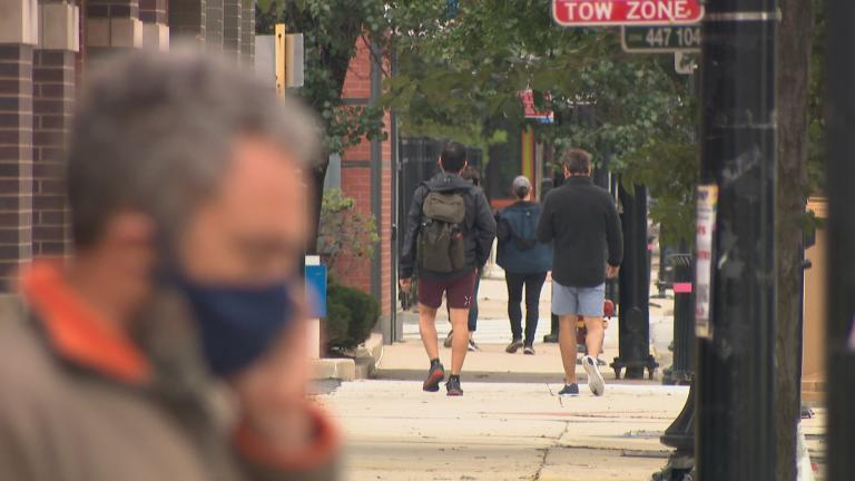 Pedestrians in Chicago's Northalsted neighborhood on a September day. (WTTW News)
