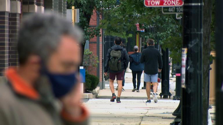 People walk in Chicago's Northalsted neighborhood in September 2020. (WTTW News)