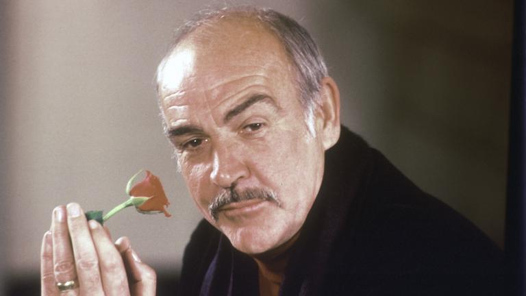 "In this Jan. 23, 1987 file photo, actor Sean Connery holds a rose in his hand as he talks about his new movie ""The Name of the Rose"" at a news conference in London. (AP Photo / Gerald Penny, File)"