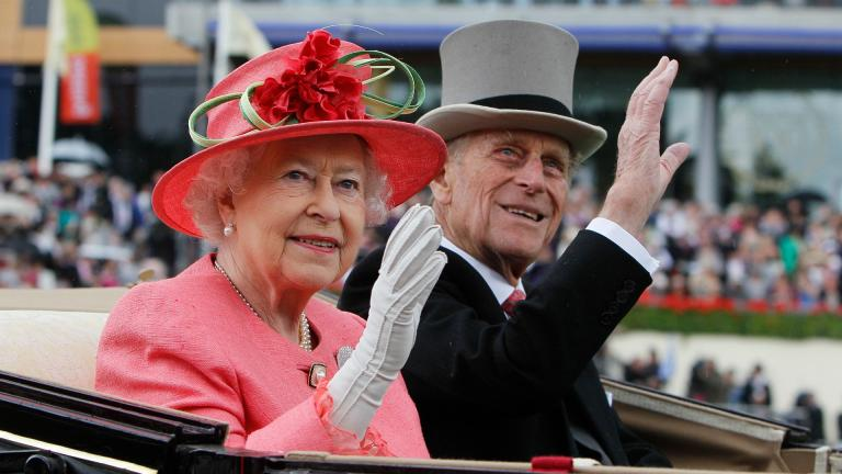 In this Thursday June, 16, 2011 file photo Britain's Queen Elizabeth II with Prince Philip arrive by horse drawn carriage in the parade ring on the third day, traditionally known as Ladies Day, of the Royal Ascot horse race meeting at Ascot, England. (AP Photo/Alastair Grant, File)