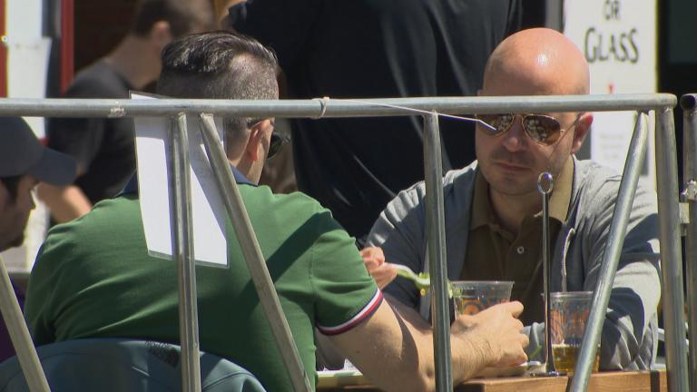 Diners take advantage of expanded outdoor seating along a stretch of Broadway in Chicago on Friday, June 12, 2020. (WTTW News)