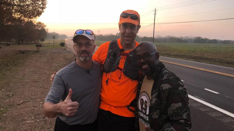 Bill Bucklew (center) is walking 2,500 miles across the country to raise funds and awareness for Parkinson's disease. (Courtesy of Bill and Heidi Bucklew)