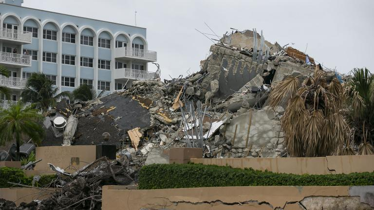 Rubble and debris of the Champlain Towers South condo can be seen Tuesday, July 6, 2021 in Surfside, Fla. (Carl Juste / Miami Herald via AP)