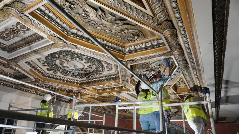 A team at work on restoring historic rooms in the Chicago Cultural Center to their original glory. (Courtesy of Harboe Architects)