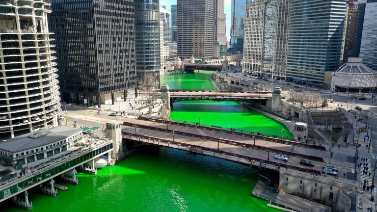An aerial picture shot with a drone shows the Chicago River as it flows through downtown after it was dyed green in celebration of St. Patrick's Day. (Scott Olson / Getty Images)