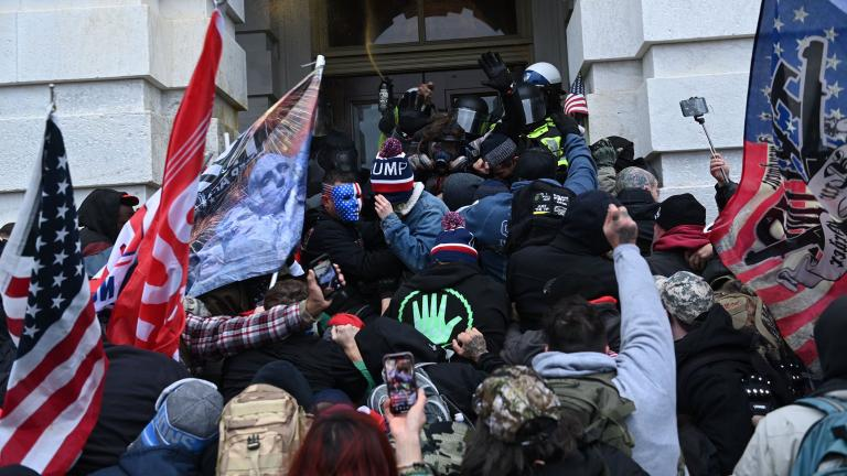 Trump supporters clash with police and security forces as they storm the Capitol in Washington, D.C. on Jan. 6, 2021.(Brendan Smialowski / AFP / Getty Images)