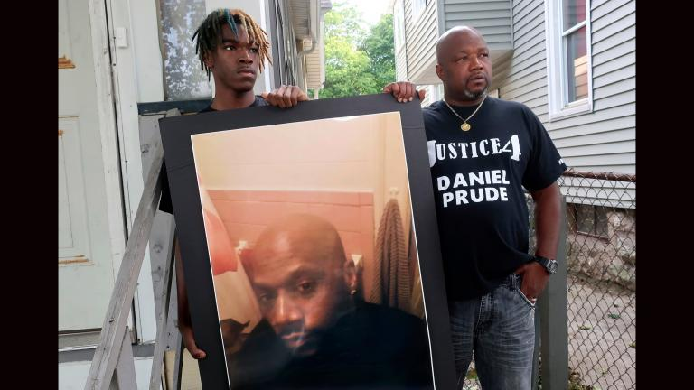 In this Sept. 3, 2020, file photo, Joe Prude, right, brother of Daniel Prude, and Daniel's nephew Armin, stand with a picture of Daniel Prude in Rochester, N.Y. (AP Photo / Ted Shaffrey, File)