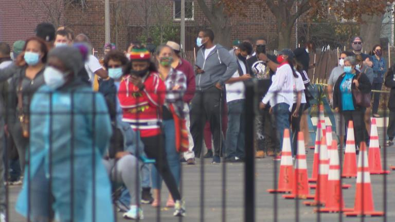 People wait in line for COVID-19 tests in Chicago. (WTTW News)