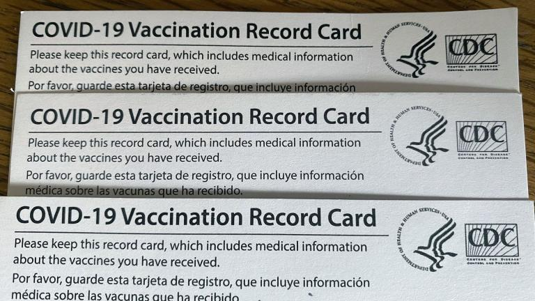 Individuals are issued a COVID-19 vaccination card when they're vaccinated. (Kristen Thometz / WTTW News)