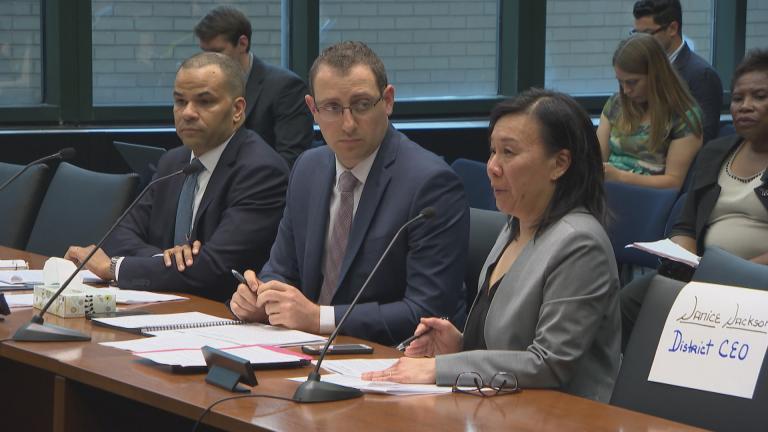CPS officials Doug Henning, left, Matt Lyons, center, and Jadine Chou attend a hearing Wednesday, June 20, 2018.