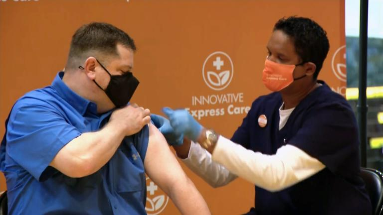 Jeff Lorenz, a teacher at Roosevelt High School, receives a COVID-19 vaccination at his school on March 17, 2021. (WTTW News)