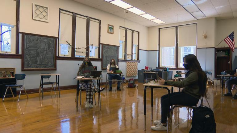 In this file photo, CPS students sit masked and socially distanced. (WTTW News)