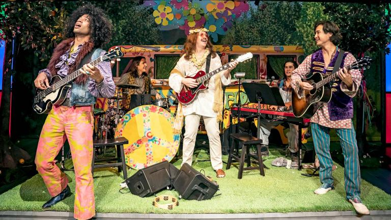 """The Forest Lords of Arden (left to right: Austin Eckert, Jeff Kurysz, Adam Wesley Brown, Michael Daniel Dashefsky, Kurt Schweitz) jam to the hit song of The Beatles in Chicago Shakespeare Theater's production of """"As You Like It,"""" adapted and directed by Daryl Cloran, in the Courtyard Theater, Oct. 6–Nov. 21. (Photo by Liz Lauren)"""