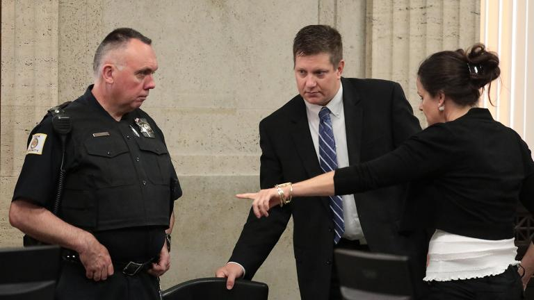 Chicago police Officer Jason Van Dyke stands and heads toward the judge's bench at a hearing for the shooting death of Laquan McDonald at the Leighton Criminal Court Building on Tuesday, Aug. 14, 2018. At right is his attorney Tammy Wendt. (Antonio Perez / Chicago Tribune / Pool)