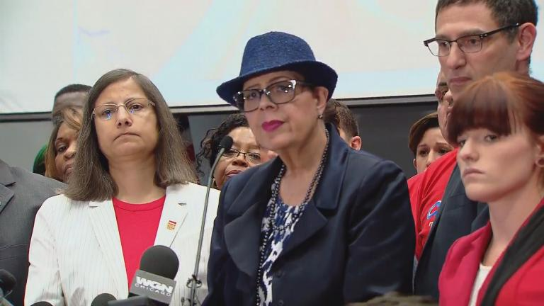 Karen Lewis and members of the Chicago Teachers Union announce on Sept. 28 a strike date of Oct. 11 if no contract agreement is reached with Chicago Public Schools. (Brandis Friedman / Chicago Tonight)