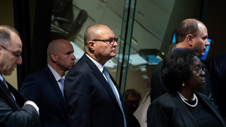 Background: Ex-Officer Joseph Walsh, second from left, former Detective David March, center, and Chicago police Officer Thomas Gaffney arrive in court on the first day of trial on Tuesday, Nov. 27, 2018. Foreground: Special prosecutor Patricia Brown Holmes, right, and special prosecutor Ron Safer, left. (Zbigniew Bzdak / Chicago Tribune / Pool)