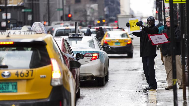 Chicago taxi drivers protest ride-sharing services like Uber and Lyft by holding signs and driving around City Hall in February 2015. (ScottMLiebenson / Wikimedia Commons)