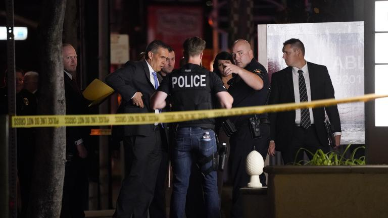 Investigators gather outside an office building where a shooting occurred in Orange, Calif., Wednesday, March 31, 2021. (AP Photo / Jae C. Hong)