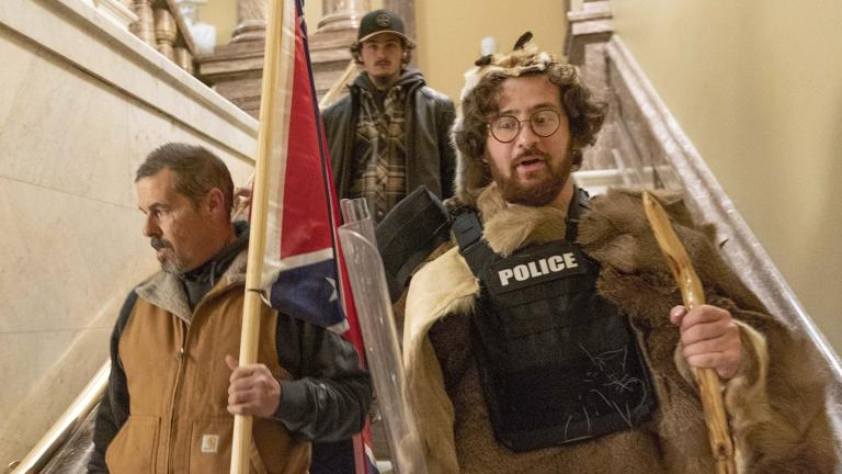 In this Jan. 6, 2021 file photo, insurrectionists loyal to President Donald Trump, including Aaron Mostofsky, right, and Kevin Seefried, left, walk down the stairs outside the Senate Chamber in the U.S. Capitol, in Washington. (AP Photo / Manuel Balce Ceneta, File)