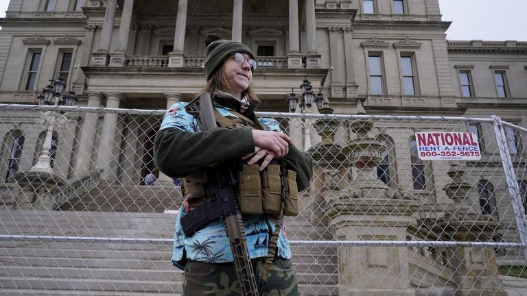 Timothy Teagan, a member of the Boogaloo Bois movement, stands with his rifle outside the state capitol in Lansing, Mich., Sunday, Jan. 17, 2021. (AP Photo / Paul Sancya)