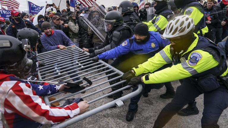FILE - In this file photo from Wednesday Jan. 6, 2021, Trump supporters beset a police barrier at the Capitol in Washington. (AP Photo / John Minchillo, File)