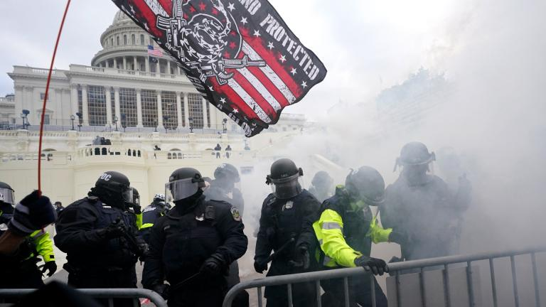 In this Jan. 6, 2021, U.S. Capitol Police officers hold off rioters loyal to President Donald Trump at the Capitol in Washington. (AP Photo / Julio Cortez, File)