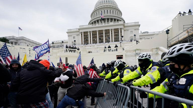 In this Wednesday, Jan. 6, 2021 file photo, Trump supporters try to break through a police barrier at the Capitol in Washington. (AP Photo / Julio Cortez, File)